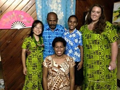 A local host family and two Projects Abroad volunteers in Fiji, South Pacific