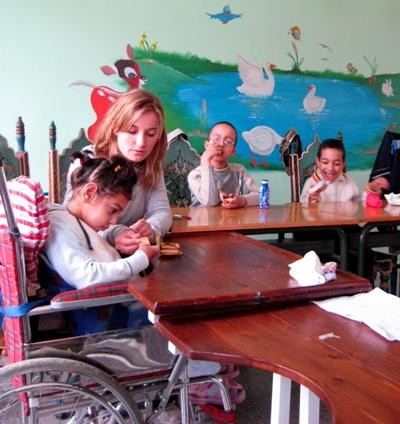 A volunteer working with special needs children in Morocco