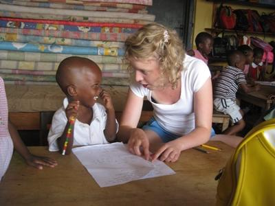 A volunteer plays with a child on the Care Project in Africa