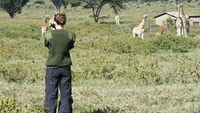 Volunteer observing animals on the Conservation project in Kenya