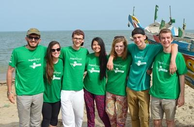 Projects Abroad volunteers from around the world enjoy a day at the beach in Africa.