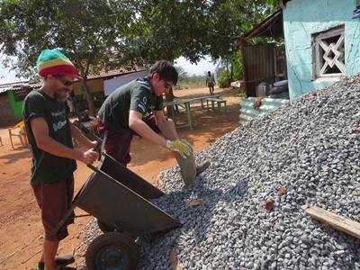 Volunteers laying blocks on the Building project in Asia