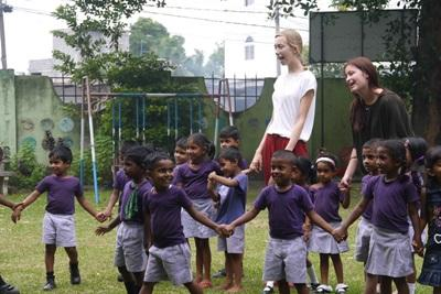 Volunteer with children on a Care Project in Cambodia with Projects Abroad.