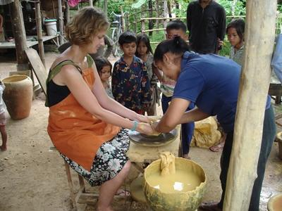 Volunteer learning to do pottery with locals on the Culture & Community project in Asia