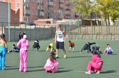 Volunteer with students coaching sports at a school in Asia.