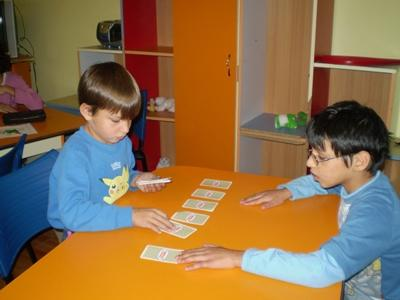 Children play card games at a Projects Abroad Project placement in Europe.