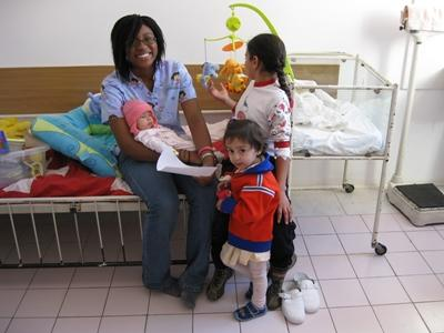 A volunteer with children in the pediatrics ward of a hospital in Europe.