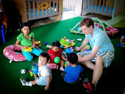A volunteer plays with young children on a Care Project in Ecuador with Projects Abroad.