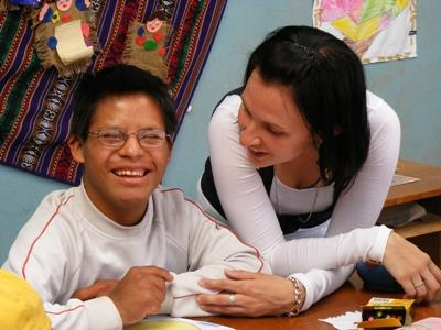 A volunteer works with a special needs child at a care center in Peru with Projects Abroad.