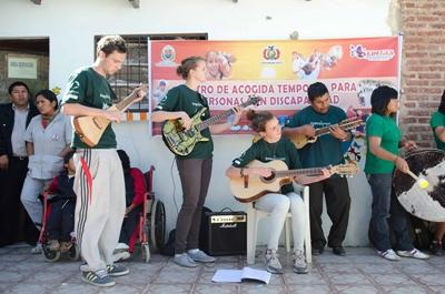 Volunteers create a band with various instruments to teach children on the Performing Arts Project in Latin America