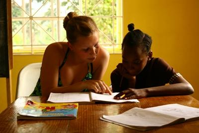 Teaching volunteer with a child on a project in Jamaica