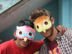 Volunteer and a child wearing face masks at a childcare project placement in South America