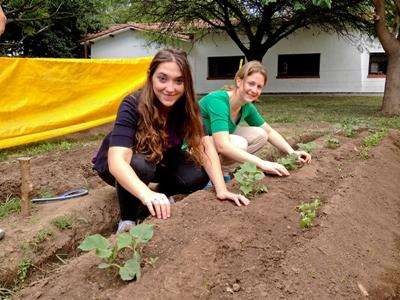 Volunteers planting seeds on a community farm on the Farming Project in South America