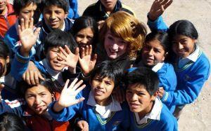 Teaching volunteer with her students at a school in Peru, South America