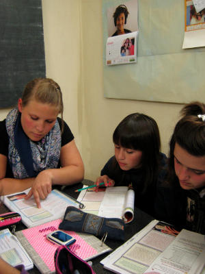 Volunteer on the Teaching project in South America tutoring school children in South America
