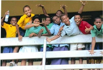 Children in the South Pacific outside of their school in a Projects Abroad volunteer placement