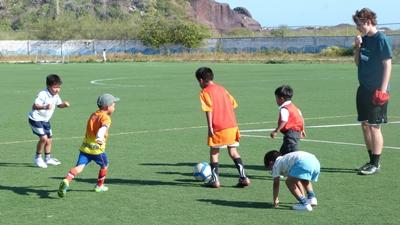 Volunteer coaching soccer on the Sports project in the South Pacific