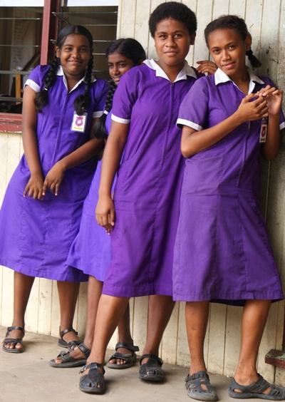 Female students dressed in school uniforms outside of a school on the Teaching project n the South Pacific