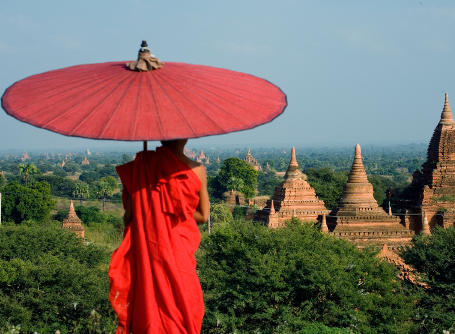 A Buddhist monk gazes over a view of ancient temples in Myanmar, also known as Burma, in Asia