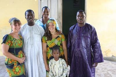 Projects Abroad volunteers with their local host family in Senegal, Africa
