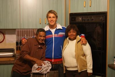 Male volunteer with his host family in their home in Cape Town, South Africa