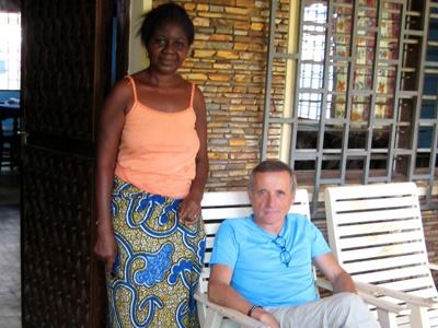 Volunteer and host family outside home in Togo
