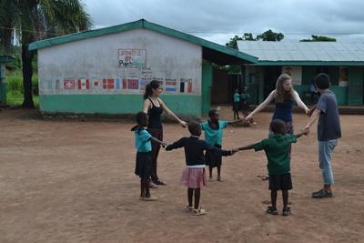 Projects Abroad volunteers play a game with Ghanaian children in Africa