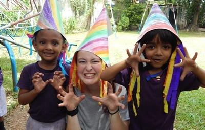 Projects Abroad Care & Community volunteer plays with Sri Lankan children in Asia