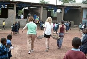 Volunteers on the Alternative Spring Break Care Project in Ghana spend time with children doing arts & crafts activities.