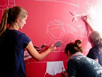 A colourful mural takes shape at a Care project in Argentina, South America.