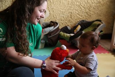 Projects Abroad Care volunteer spends time with a young baby at a care center in Costa Rica