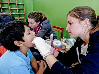 On medical outreaches, Public Health Alternative Spring Break volunteers in Peru conduct check-ups in local communities
