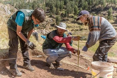 Projects Abroad volunteers on the Archaeology Project in Peru assist a staff member at an excavation site in Sacsayhuaman