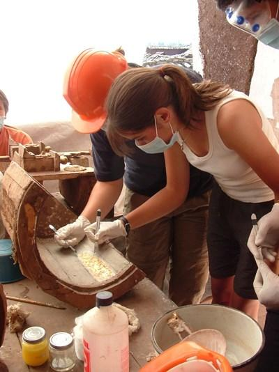 A volunteer is guided by a staff member on an Archaeology Project abroad