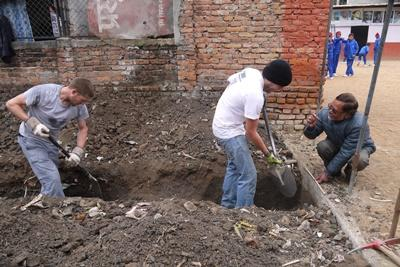 Projects Abroad Disaster Relief volunteers dig foundations for a new classroom at a local school in Kathmandu, Nepal