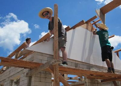 Projects Abroad volunteers help construct a roof for a new house at the Building Project in the Philippines.