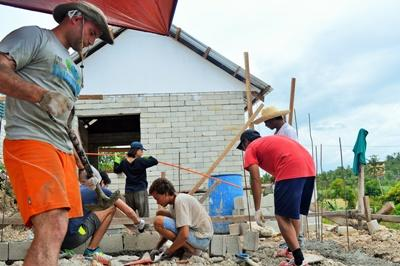 Projects Abroad volunteers work at a construction site at the Building Project in the Philippines, Asia.