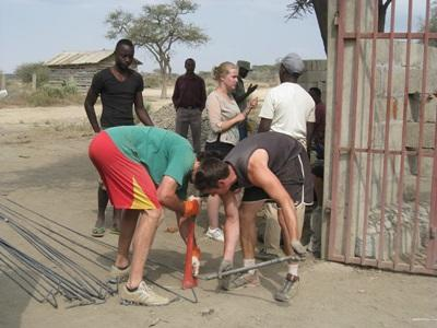 Gap Year volunteers lift materials for the Building project in Tanzania