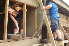 Volunteers help build a house for a local family in Ghana.