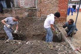 Volunteers help dig the foundation for a new classroom during their Building Project in Nepal.