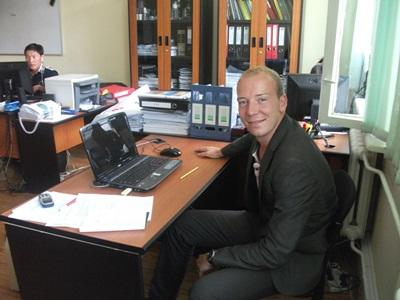 A Projects Abroad intern works in a professional office environment abroad during his Business internship.