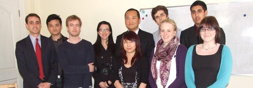 A group of colleagues and Projects Abroad interns at a business internship placement abroad.