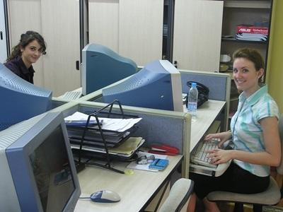 Volunteers working in an office abroad, on the Business Project