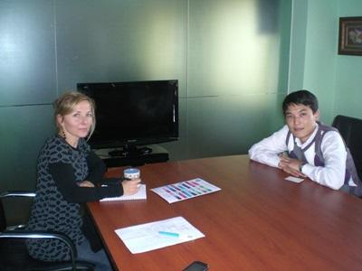 A Projects Abroad Business intern in Mongolia consults with local staff.