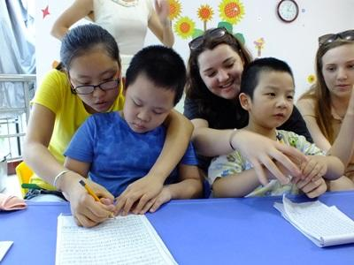 Children with special needs in China finish an educational activity with the help of Projects Abroad volunteers.