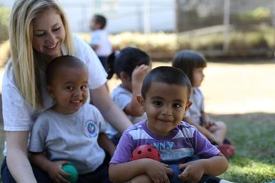 A Projects Abroad volunteer and the children at aday care centre t in Costa Rica enjoy the outdoors together.