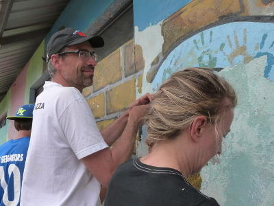 Projects Abroad volunteers assist with the renovation of a building at a disadvantaged kindergarten in Ecuador.