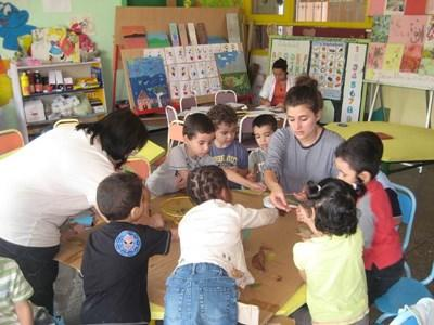 Projects Abroad volunteer runs an educational activity for children at a child care centre in Morocco, Africa.
