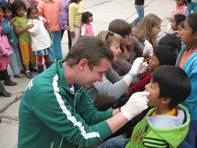 Projects Abroad volunteers perform dental checkups for local children at in child care centres in Peru, South America.