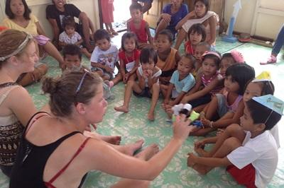 Projects Abroad volunteers spend time with local children at the beginning of the day at a kindergarten in the Philippines.